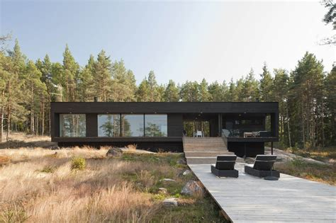 Lakeside Summer Home by Entry To Summer Villa Slices Through Home To Inlet Dock