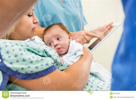 Babygirl With Loving Mother In Hospital Royalty Free Stock