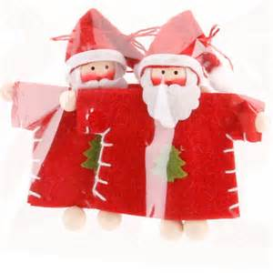 lots of felt fabric christmas tree hanging decorations santa animals gingerbread