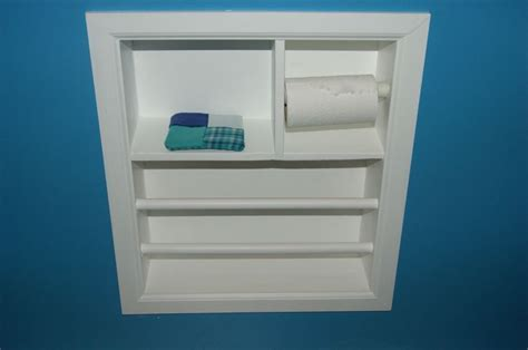 Wall insert toilet paper holder, cup holder, and magazine