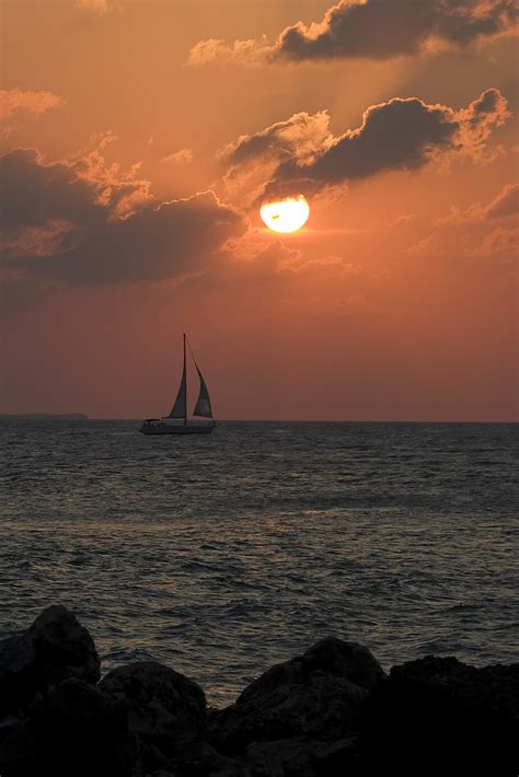 Key West Sailboat by Key West Sailboat At Sunset Sailboat At Sunset Seen From