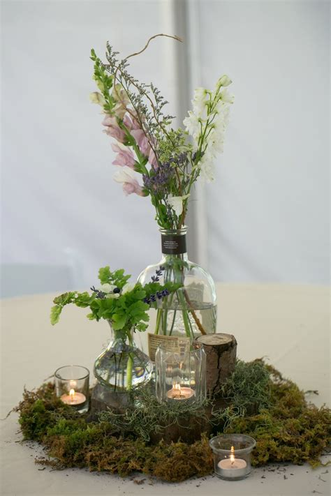 Repurposed Bourbon Bottles Moss Ferns And Wood Pieces
