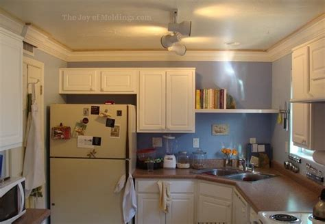 how to cut crown molding for kitchen cabinets kitchen with crown molding offapendulum 9892