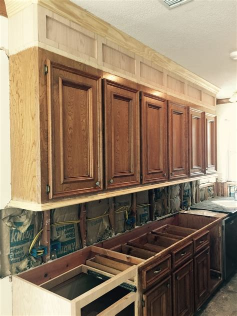 why dont kitchen cabinets go to the ceiling how to make ugly cabinets look great designed