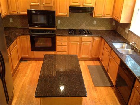 granite countertops with brown cabinets tan granite countertops kitchen traditional with tan brown