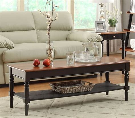 If you've got an upholstered coffee table, like an ottoman, try using a runner to play with patterns. French Country Coffee Table Design Images Photos Pictures