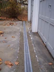 trench drain in front of garage door wageuzi With garage floor slope to drain
