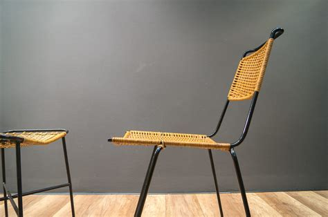 mid century wicker chair and stool by paul schneider