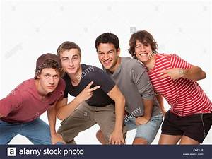 Teenagers four male boys rear view group 4 Stock Photo ...