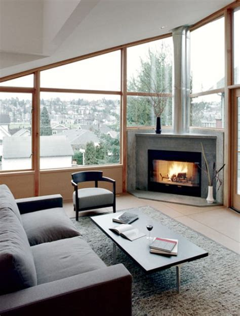 living room with fireplace and windows corner fireplaces a simple way of spreading a wonderful