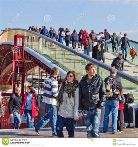 people crossing bridge  piazza roma venice editorial