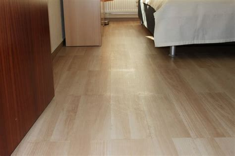 can you wax vinyl plank flooring upgrading a room floor with self adhesive vinyl floor planks with the help of hydraulic car jack