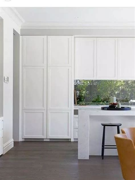 White shaker cabinetry with black countertops and glass by south shore decorating. 12 Popular Hardware Ideas for Shaker Cabinets | White ...