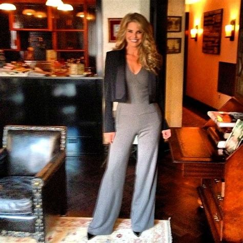 christie brinkley shows   perfect curls  figure