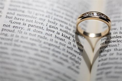 creating a wedding ring bible love verse and heart shadow photograph