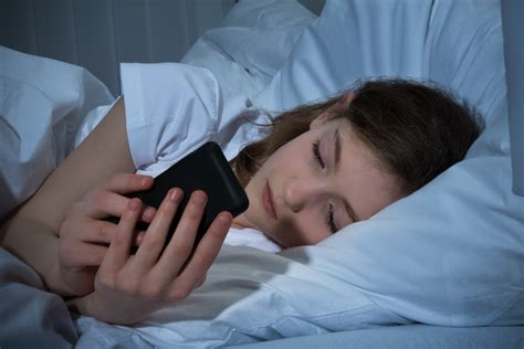 teen cell phone with mobile phone on bed netsanity