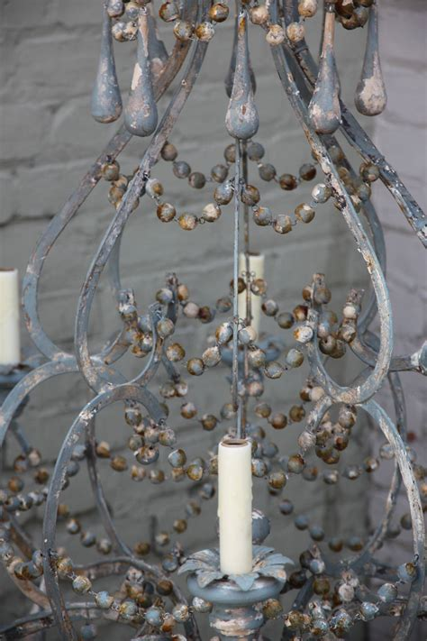lighting and chandeliers iron and wood beaded eight light painted chandelier