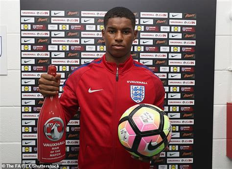 Marcus Rashford shows his trophy cabinet filled with ...