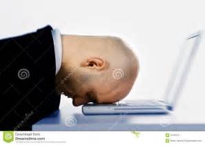 Man Banging Head On Computer