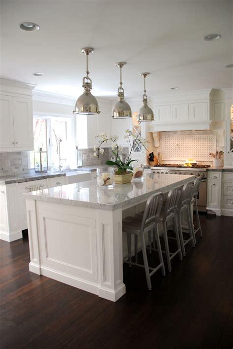 white marble kitchen island the granite gurus carrara marble white quartzite