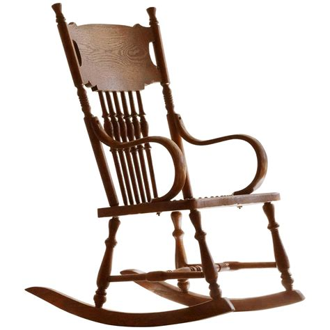 antique child s rocking chair with tooled leather