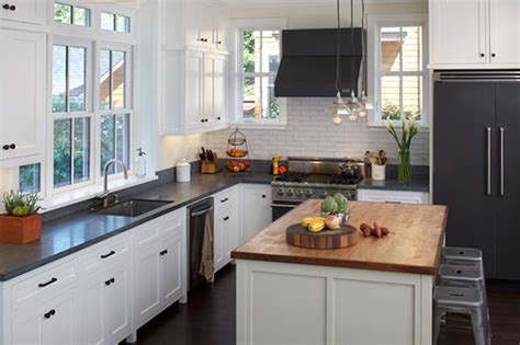 Amusing White Kitchen With Black Appliances And Cream Wall