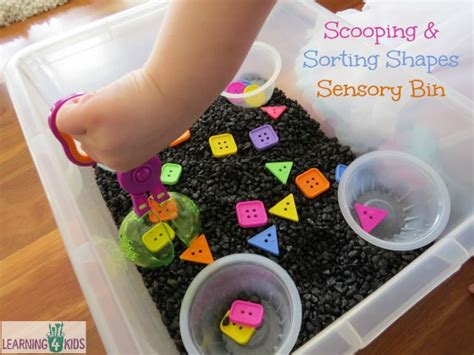 sorting shapes in our sensory bin learning 4 690 | Scooping and Sorting Shapes Sensory Bin by learning 4 kids