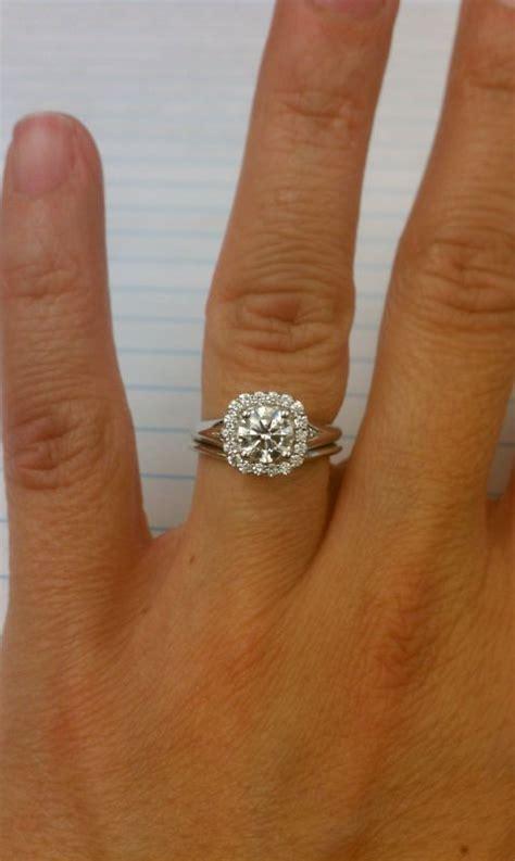 my upgraded e ring cushion halo with round diamond