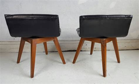 pair of button tufted swivel vanity chairs or stools at