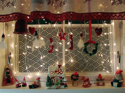 hanging christmas ornaments in window christmas kitchen window southwestdesertlover
