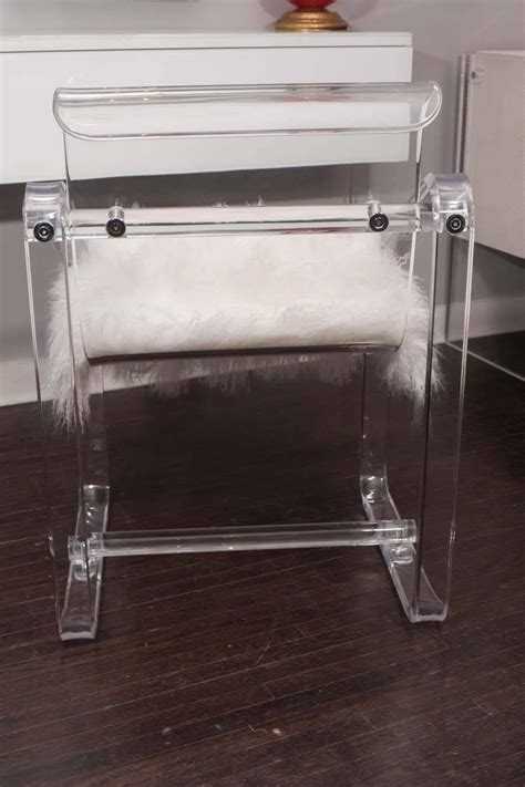 vintage 1970s lucite desk chair with new mongolian lamb