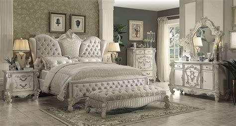 acme versailles  piece upholstered bedroom set  ivory