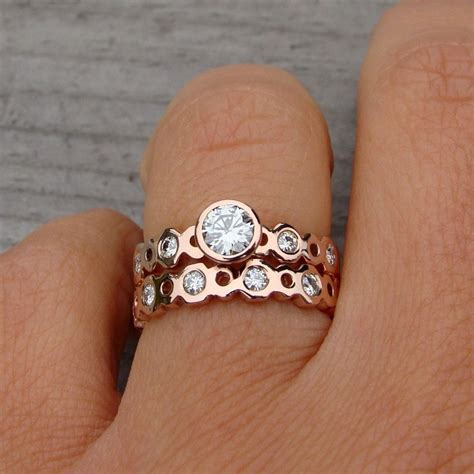 hand made moissanite and recycled 14k rose gold engagement