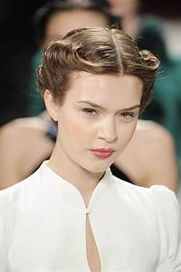 A chic '40s-style rolled updo kept the hair off the face ...