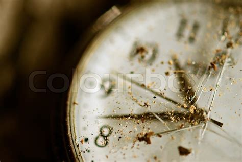 Tinted Image Dusty Pocket Clock With Broken Glass Shallow Depth Of