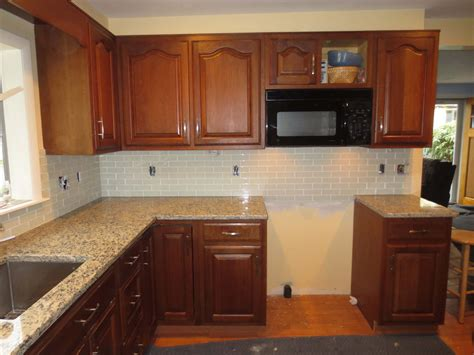 how to install a backsplash in kitchen how to install a glass tile kitchen backsplash part 2