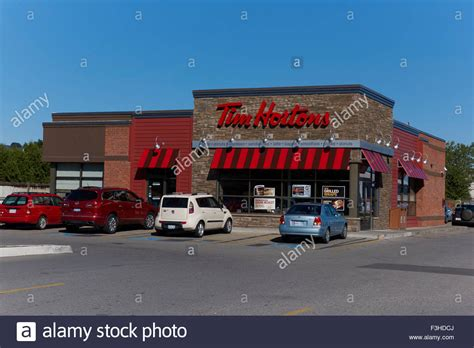 In 1964, tim opened a coffee and donut shop in his neighborhood setting out to create a place where anyone could go at any time and feel at home. Tim Horton Coffee Shop Sign On The Outside Of A New Corporate Design Stock Photo - Alamy