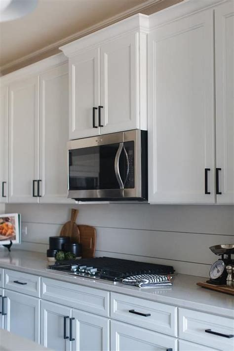 Shop with afterpay on eligible items. White shaker kitchen cabinets accented with oil rubbed bronze pulls and an… | White shaker ...