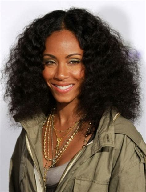 medium black curly hairstyle high volume natural waves