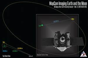 Asteroid-bound spacecraft snaps color pic of Earth and Moon