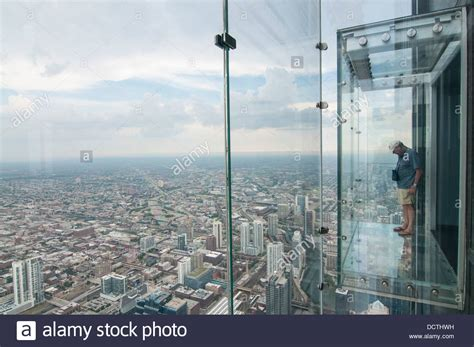 male tourist in the skydeck at the sears now willis