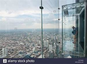 Male tourist in the SkyDeck at the Sears (now Willis ...