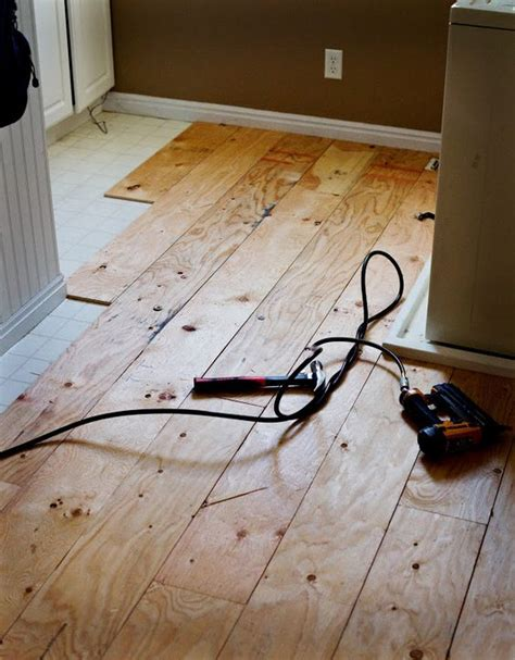 linoleum flooring on plywood diy plywood planks 8 quot strips on top of linoleum then painted diy projects pinterest