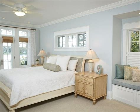 light blue beige white bedroom with light wood furniture