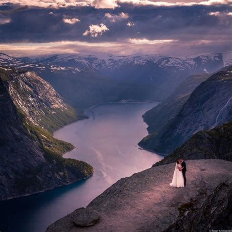 Bride And Groom On The Edge Of Trolltunga Norway