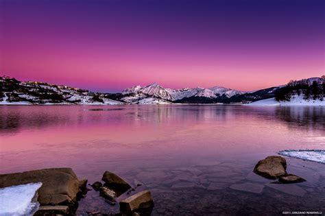 sunset   frozen lake campotosto graziano