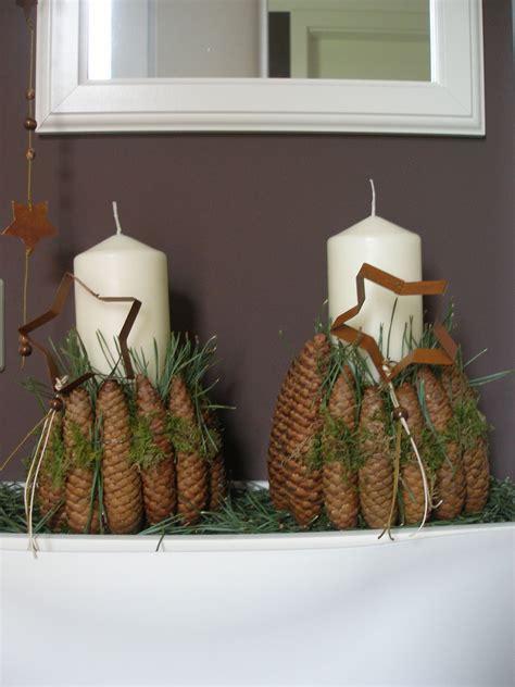 weihnachtsdeko mit kerze und zapfen solebichde