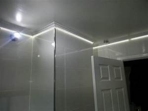 led tape is concealed behind coving in this bathroom With coving for bathroom ceilings