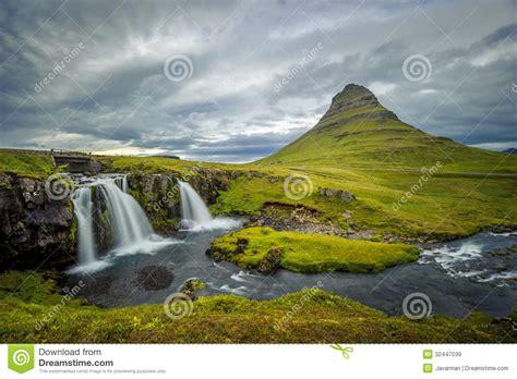 Kirkjufellsfoss Waterfall And Kirkjufell Mountain Iceland