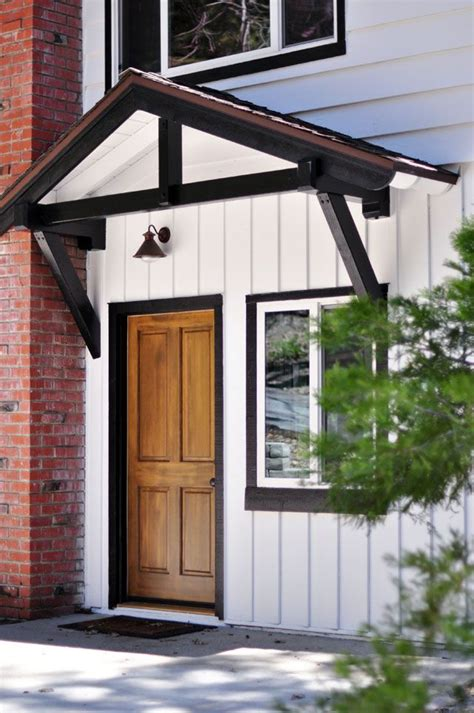 white  black trim solid wood door lake house nest   white exterior houses